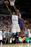 Marcus Ginyard 1 of the North Carolina Tar Heels goes up for a shot against Trevor Booker 35 of the Clemson Tigers during the final of the 2008 Men's ACC Basketball Tournament at Bobcats Arena on March 16 2008